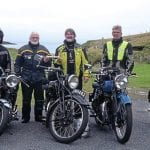 Joe Gray and Frank Johnson, in the centre with the baton, at the end of the public road on Unst, which is as far north in the UK as you can get.