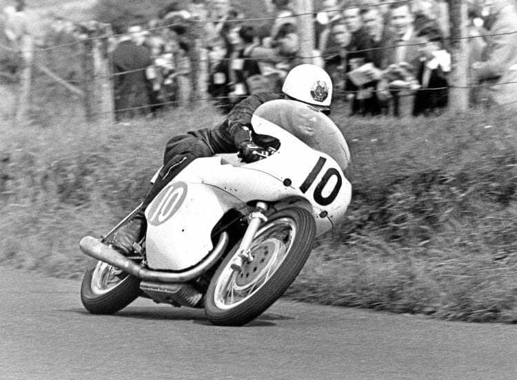 A Tribute to Bob Mac - Always prepared to try something new, McIntyre gallops the factory 350cc Bianchi twin in the 1961 Ulster Grand Prix.