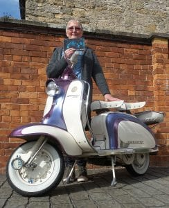Sheila is reunited with a Lambretta after many years (thanks to John Carter for the loan of the scooter)
