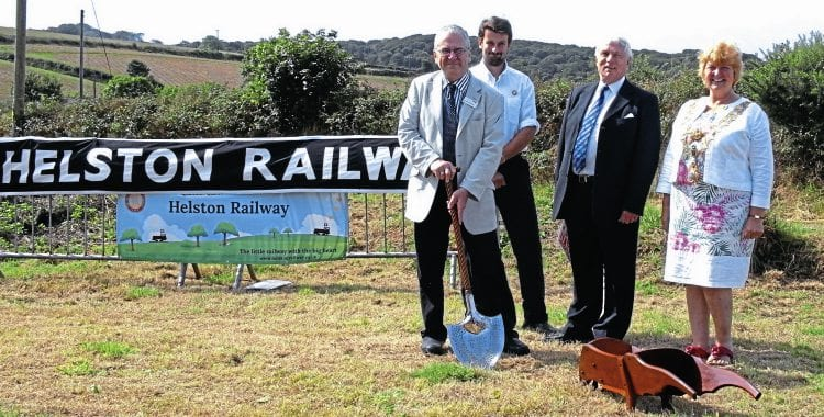 The cutting of the sod: left to right are Sir Peter Hendy, James Packman (chairman of the Helston Railway's operating company), Chris Heaps and mayor Gillian Geer. HRPS