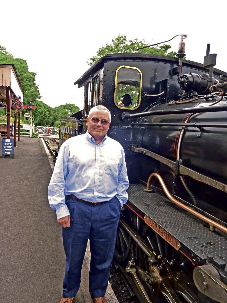 Tender moments: Shaun Dewey, general manager of the Kent & East Sussex Railway, with No. 376 Norwegian at Tenterden station on August 13. The 2-6-0, built in 1919 by the Swedish firm Nyquist & Holm for the Norwegian State Railway, was brought to the UK in 1971 after being purchased privately, and is the only tender locomotive on the KESR. GEOFF COURTNEY