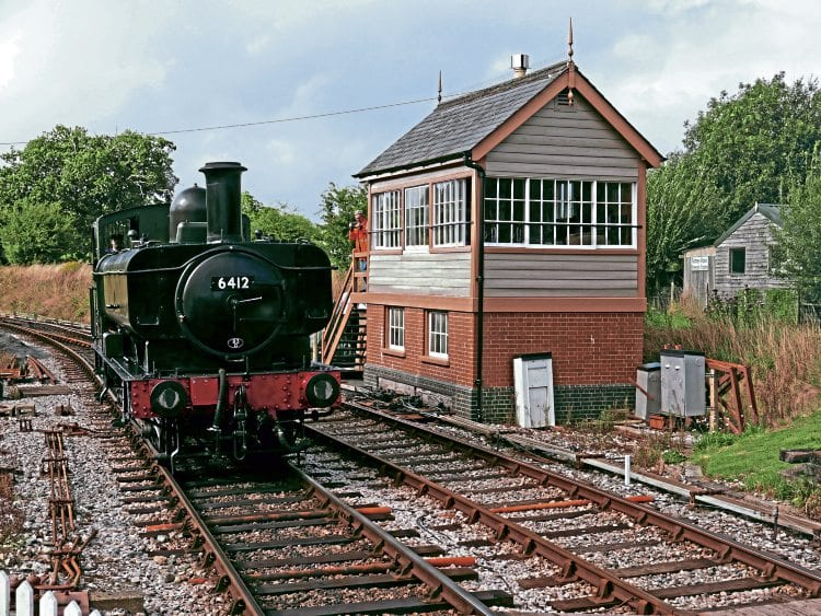 GWR 0-6-0PT No. 6412 passes the new Ashburton Junction signalbox as it runs round its train on August 21.