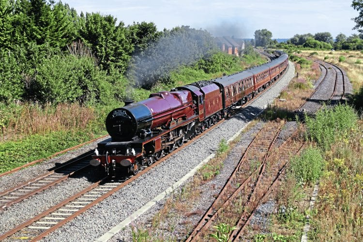 LMS Princess Royal Pacific No. 6201 Princess Elizabeth passes Aldermaston with Steam Dreams' 'Cathedrals Express' from Victoria to Minehead on August 23. KEN LIVERMORE