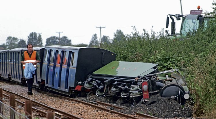 No. 1 Green Goddess lying on its side at the head of the derailed train on September 10. It will now have to be dismantled to assess the extent of the damage. THE LOOKER