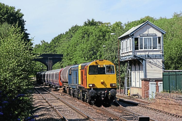 Harry Needle Railroad Co. Class 20 No. 20314 leads a convoy of London Underground tube stock into Melton Mowbray on August 24 en route from Old Dalby to Amersam. BRIAN SHARPE