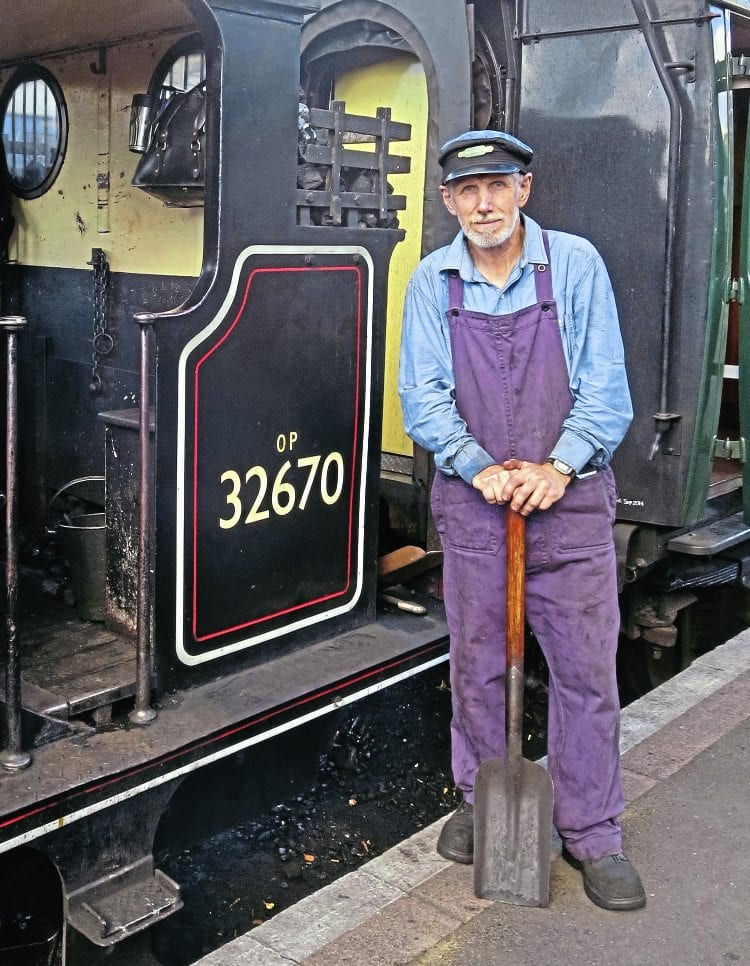Fired up and ready to go: Long-distant volunteer John Bryant with A1X 'Terrier' 0-6-0T No. 32670 during a visit to the Kent & East Sussex Railway on September 11. IAN SCARLETT