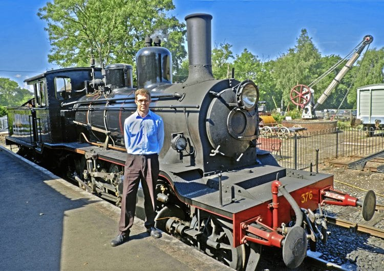Catering for the future: André Freeman, who has been appointed commercial manager at the Kent & Sussex Railway after 14 years as catering manager, in the company of 2-6-0 No. 376 Norwegian at Tenterden station. ALAN CROTTY