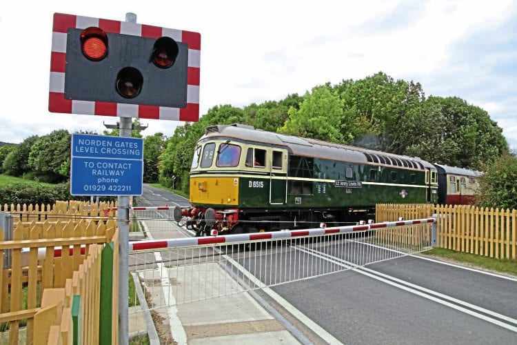 Class 33 D6515 Lt Jenny Lewis RM crosses the Norden Gates level crossing on October 6. ANDREW P M WRIGHT.