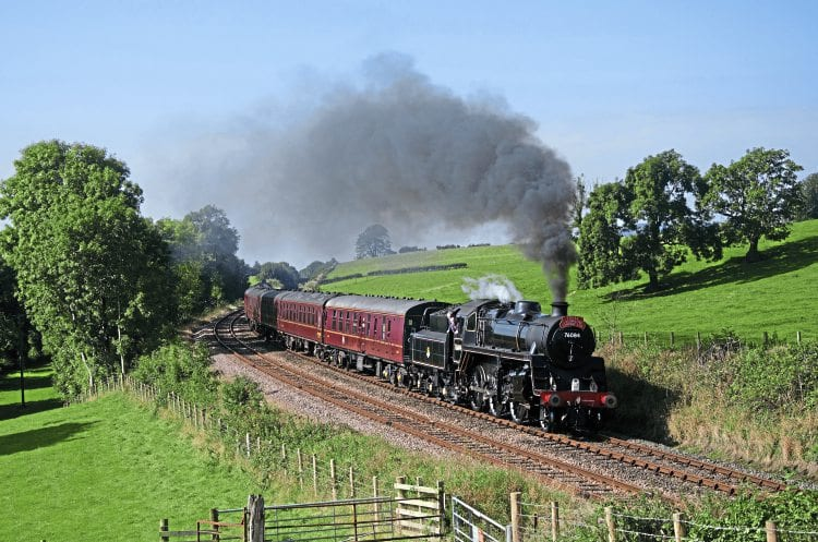 BR Standard 4MT 4-6-0 No. 76084 passes Starrick's Farm on its main line proving run from Carnforth round the Hellifield - Blackburn circuit on September 20. DAVID PRICE