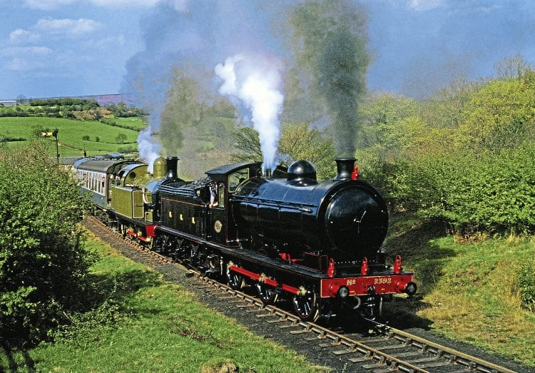 Sporting four red lamps, NELPG's immaculate P3 No. 2392 pilots Lambton Tank No. 29 on the NYMR-reopening Royal train conveying the Duchess of Kent from Grosmont to Pickering at Esk Valley on May 1, 1973. MAURICE BURNS