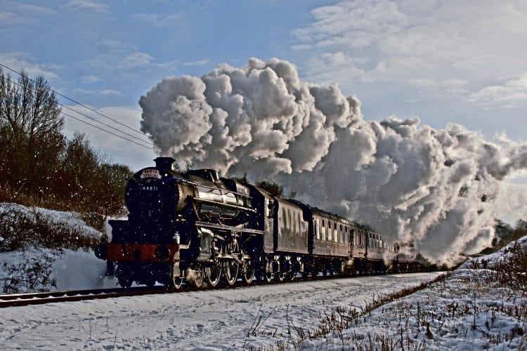 LMS 'Black Five' No. 44871 powers through a snow shower with an East Lancashire Railway Santa special. ELR