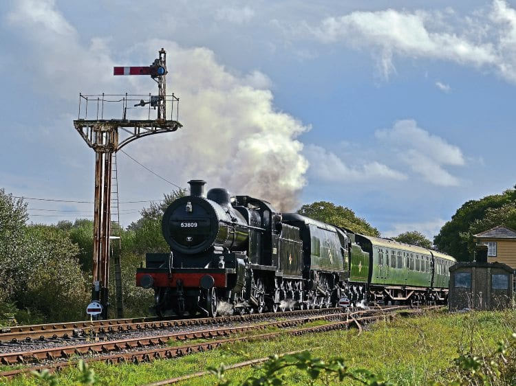 No. 53809 and No. 34070 Manston depart from Harmans Cross. JAMES CORBEN