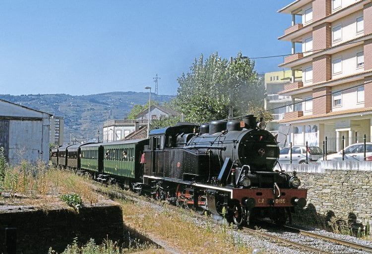 A fully loaded 'Douro Historical Train' leaves Régua on Sunday, September 11 behind 2-8-4T No. 0186.