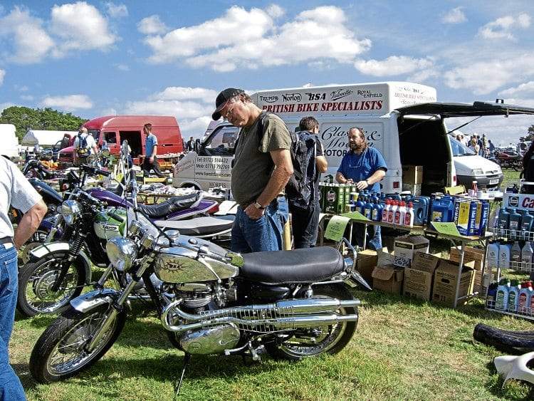 Netley Marsh Eurojumble visitors inspect some of the classic bikes for sale.