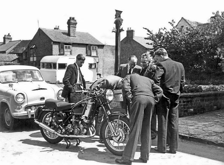 An interested group gather round a 500cc 'flat top' Scott being road testeed by Motor Cycling's Midlands editor Bernal Osborne in 1958