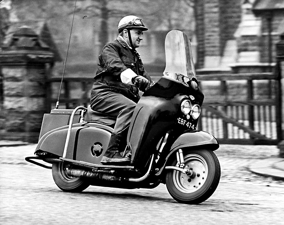 The late lamented Bob Currie looks comfortable as he tries out a 249cc Villiers two-stroke twin-powered DMW Deemster, neither scooter nor motorcycle, in the early 1960s. The model was adopted for rural patrol duties by several constabularies in Wales and the Midlands, and a later version was powered by the Velocette Viceroy flat-twin two-stroke engine.