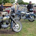 The amazing build quality of NSU motorcycles is more than evident in this photo taken at a typical British gathering – and just look at those Prima scooters as well.