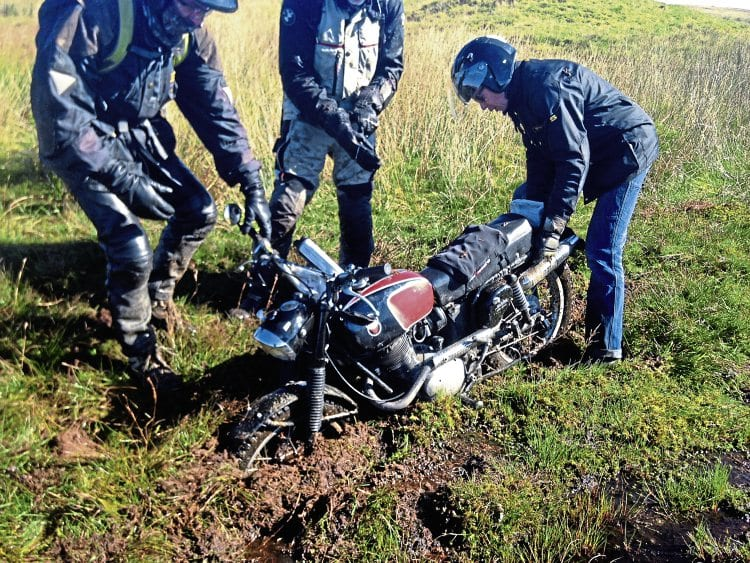 It's that sinking feeling as a rare and beautiful Gilera gets caught in a bog during this year's Beamish Trophy Trial. Photos by Phil Model.