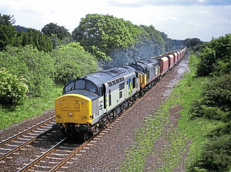 The early 1990s saw a pair of Class 37s rostered to the Washwood Heath stone job, as illustrated by Nos. 37686 and 37676 in charge on June 29, 1991. The pair are seen heading the empty wagons north through Duffield, Derbyshire, as an additional 6Z15/13.30 Washwood Heath to Peak Forest RMC. No. 37686 was withdrawn in 2000 and scrapped in 2006, but No. 37676 survives in store with West Coast Railways at Carnforth. Phil Chilton