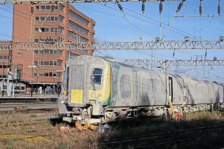 Its future uncertain, 'Desiro' No. 350264 is pictured on September 23, after being moved to Watford station. This was the leading unit that was derailed in the nearby incident and then struck by classmate No. 350233. Note how the unit is covered in a layer of mud, while the right-hand side of the cab is wrapped in plastic. Mark Lawrence