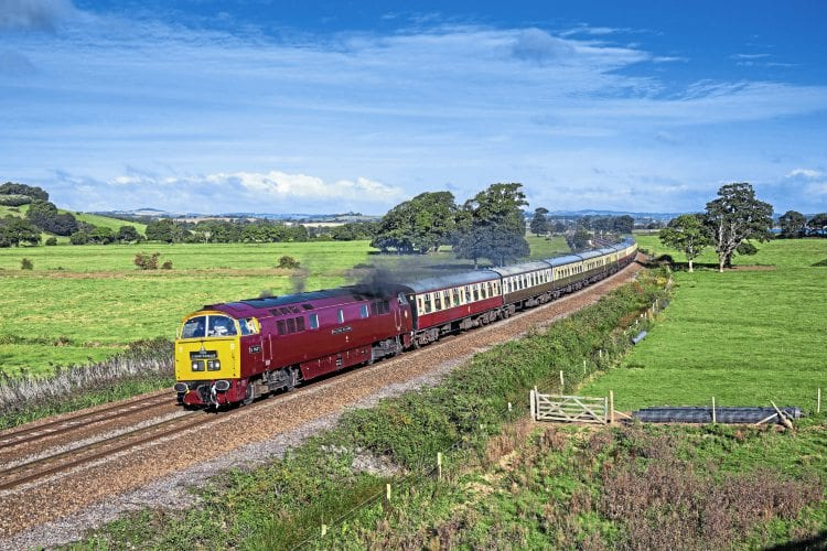 Looking great on home ground, the DTG's No. D1015 Western Champion, masquerading as scrapped classmate No. D1071 Western Renown, passes Powderham, Devon, on September 17, with Pathfinder's 05.07 Tame Bridge Parkway to Penzance. Ron Westwater