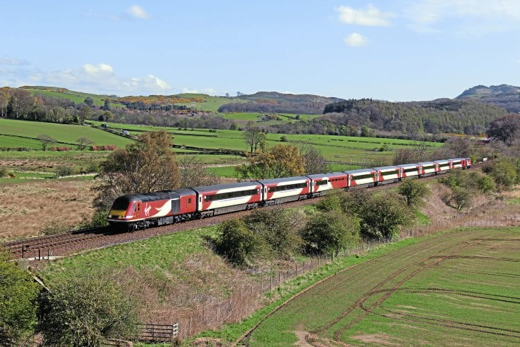 On April 26, a Virgin Trains East Coast set, led by power car No. 43206, climbs to Dalgety summit, just west of Aberdour, with the 07.52 Aberdeen-King's Cross train. IAN LOTHIAN (INSET): The nameplate of Class 91 No. 91101.