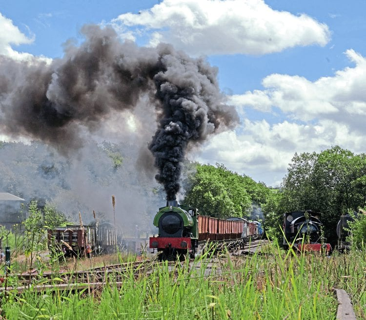 Running in the guise of long-lost classmate Hurricane, Hunslet 'Austerity' Whiston begins its climb away from Foxfield Colliery on July 17. MIKE TAYLOR