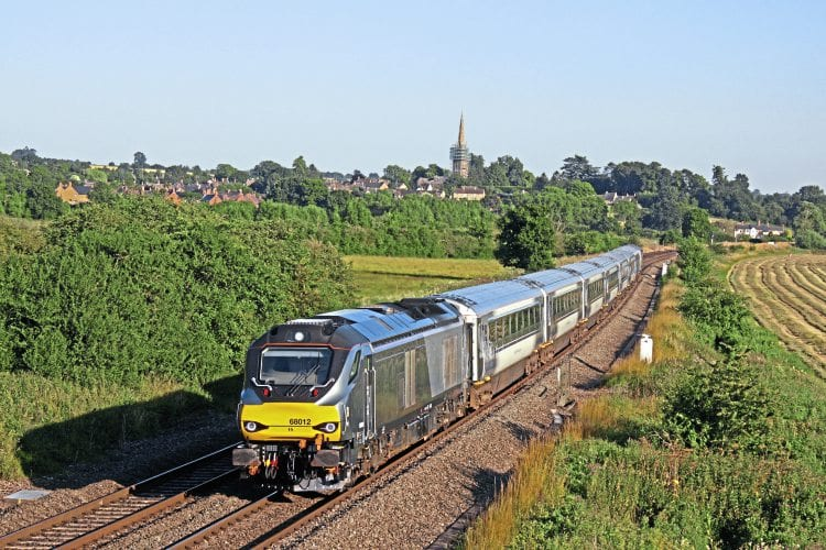 Chiltern Class 68 No. 68012, with DVT No. 82309 at the rear, passes Kings Sutton, near Banbury, during the evening of July 19 with the 17.21 London Marylebone-Banbury service. PAUL BIGGS