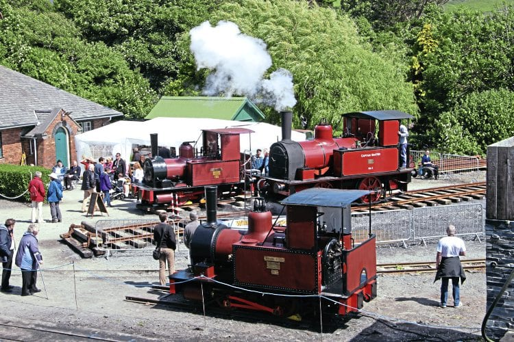 The Bluebell Railway's standard gauge Fletcher, Jennings 158/1877 Captain Baxter (centre) in steam at 2ft 3in-gauge Talyllyn Railway's Wharf station, flanked by 172L/1880 Townsend Hook (far side) and 173L/1880 William Finlay (near side). CLIFF THOMAS