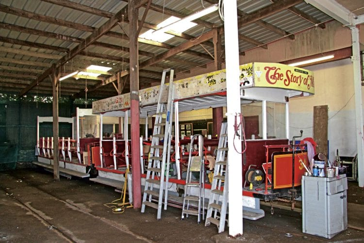 Pictured inside Strathallan Depot on July 29 are two of the Douglas Bay Horse Tramway vehicles currently out of use (nearest camera is 1896-built Bulkhead Toast Rack No. 34) sold at auction on August 27. CLIFF THOMAS