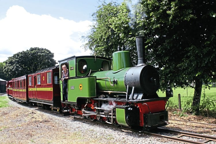 O&K 0-6-0WT Pedemoura pulls its first passenger train away from Leighton Buzzard Railway's Page's Park station on July 17. Driver David Fisher, a member of the owning group and de facto restoration project leader, is understandably looking very happy. WILLIAM SHELFORD