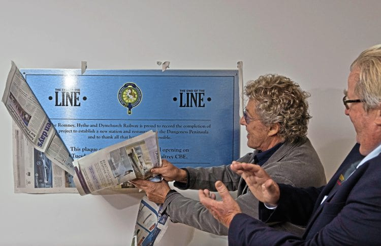Roger Daltrey tears away the covering to unveil the plaque commemorating the official opening of the rebuilt RH&DR Dungeness station as Sir William McAlpine looks on. STEVE TOWN/ROMNEY, HYTHE & DYMCHURCH RAILWAY