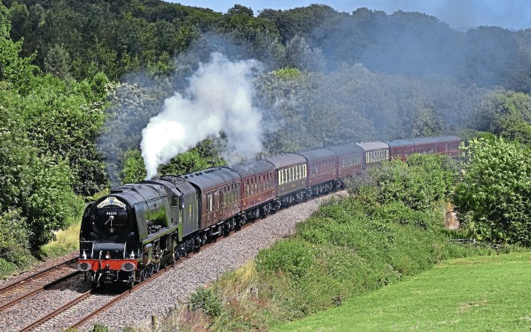 No. 46233 Duchess of Sutherland crests Dainton bank, with steam to spare on August 7, with the westbound 'Royal Duchy'. STEPHEN GINN