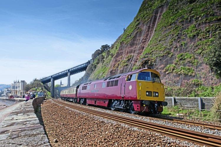 In a classic scene reminiscent of the 1960s and 70s, Class 52 No. D1015 masquerades as No. D1010 Western Campaigner heading a Pathfinder Tours charter past Teignmouth on May 7. FRASER PITHIE