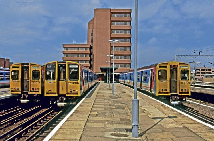 Showing two differing front-end styles, Network SoutEast Class 313 Nos. 313015, 313006 and 313005 stand at Watford Junction on July 18, 1988, displaying Croxley Green and Euston in the destination panels. BRIAN MORRISON