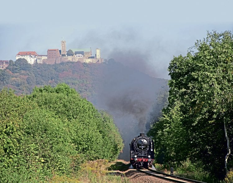 '01' Pacific No. 01 2066-7 completes the scene between Eisenach and Förtha, heading south on the 1-in-40 climb, overlooked by the historic Wartburg castle on September 15. The Wartburg was where Martin Luther translated the Hebrew and Greek bible into German.