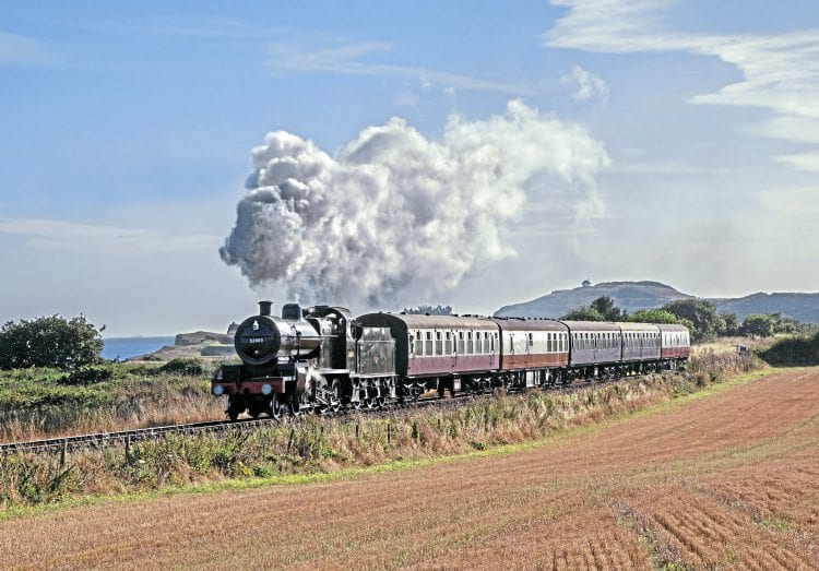 Bright, late-summer sunshine illuminates '7F' No. 53809 as it passes Sheringham golf course on September 3. ROBERT FALCONER