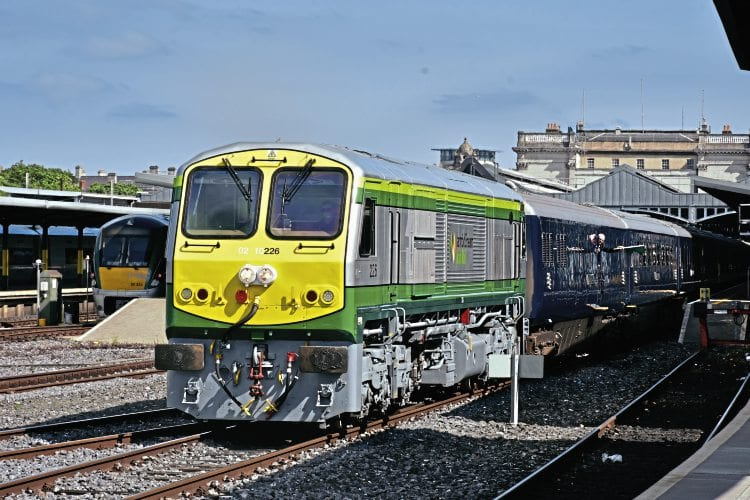 With train guard Noel Enright giving the green flag from the first coach, an immaculate No. 226 makes a prompt departure from Dublin Heuston with the 'Grand Hibernian' on August 30. NEIL DINNEN