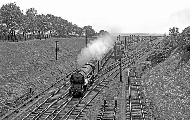 LNER 'A1' 60126 Sir Vincent Raven heads a Down passenger service through Tuxford Junction in August 1962. The west curve to the LD & ECR is to the right of the exchange sidings. J S HANCOCK