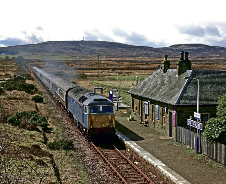 With a backdrop of a remote Caithness landscape, Class 47 No. 47712 Artemis passing Scotscalder with the 07.30 Inverness-Thurso 'Blue Pullman' special on April 16, 2006. GRAEME ELGAR