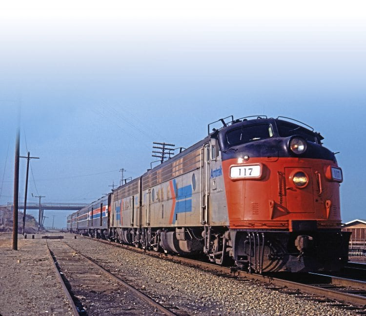 Amtrak EMD Type FP7A Nos. 117 and 112 (both inherited from Southern Pacific) wend their way across the south west states towards California in the spring of 1975. TRACKS NORTH ARCHIVE
