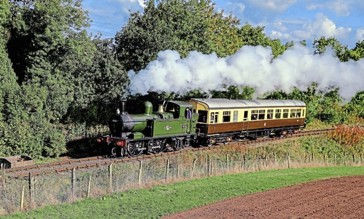 '14XX' No. 1450 trundles between Bishops Lydeard and Crowcombe Heathfield with the newly restored autocoach (ex-Railway Technical Centre) No. W233W on October 7. GRAHAM NUTTALL