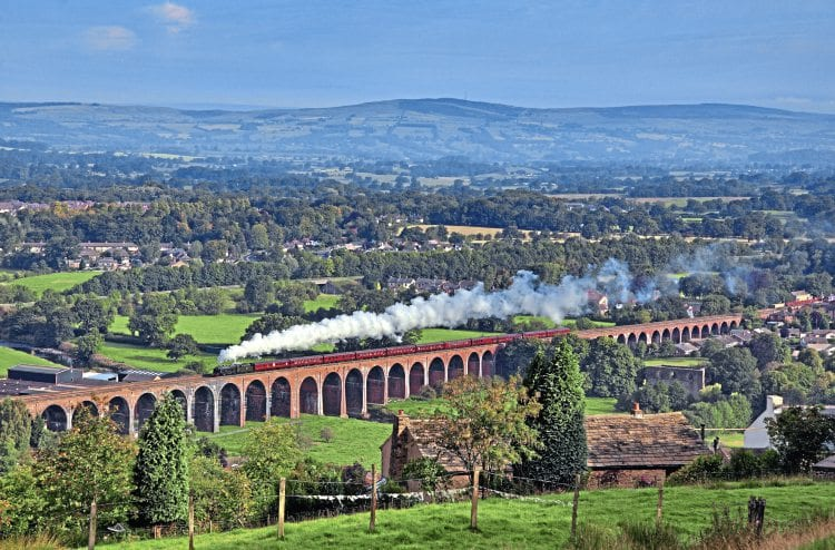 The length of the Whalley Arches is shown to good effect as Carnforth-based 'Royal Scot' No. 46115 Scots Guardsman crosses the structure with the 'Lune Rivers Trust Special' to Chester on September 4, 2010. The viaduct will undergo major strengthening and draining work. BOB GREEN