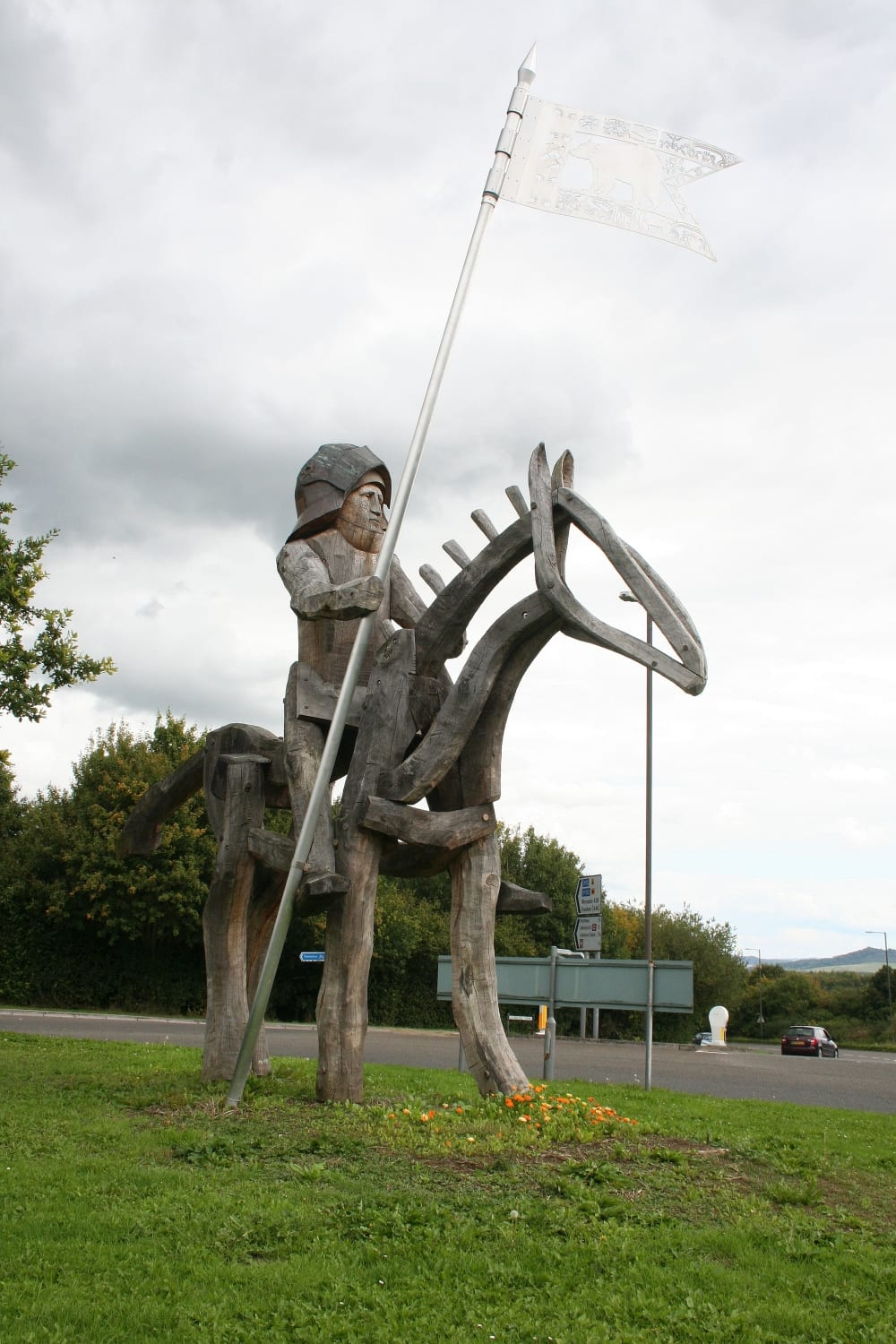 Wooden Don Quixote standing guard on a roundabout. Don't ask us why?